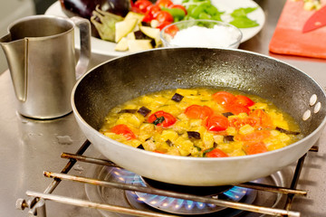 saute vegetables cooking inside pan