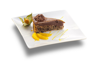 chocolate cake with nuts and orange slices