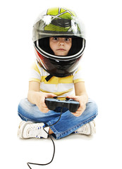 Boy with a helmet, using video game controller