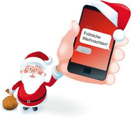 Weihnachtsmann hält Smartphone mit SMS Fröhliche Weihnachten