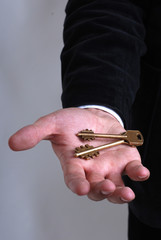 Businessman with a key in his hand