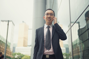 hong kong businessman in busy central district, light vintage bl