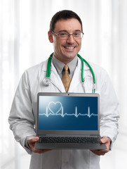 Doctor with laptop computer
