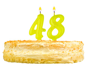 birthday cake with candles number forty eight isolated on white