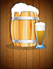 Open wooden barrel and a glass of beer