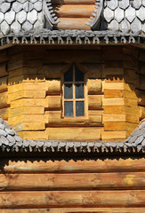 window and the wall of beautiful log house
