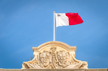Maltese flag against a blue sky - Prime minister parliament