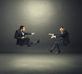 two young businessmen in fight