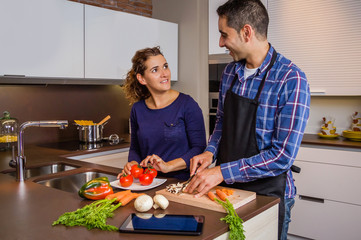 Couple in home kitchen prepairing healthy food