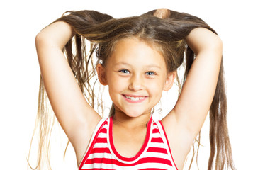 funny cheerful little girl throws her hair up