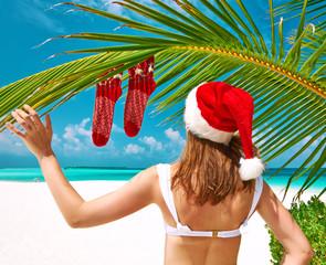 Woman in bikini on a beach at christmas
