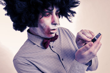 hipster zombie with an afro using a smartphone, with a filter ef
