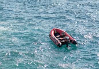 inflatable rubber transport boat floating at sea
