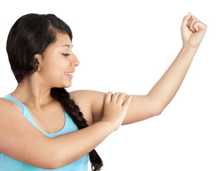 young woman showing her muscles