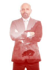 business man double exposure red tree