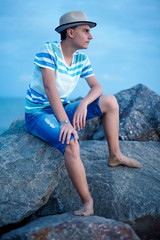 Teenager at sunset near seaside