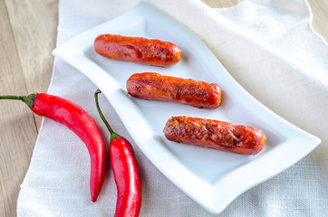 Roasted sausages on the plate