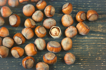 Hazelnut broken up on a wooden board