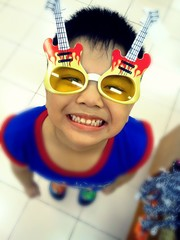 Young boy wearing funny sunglasses and smiling