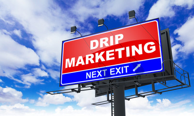 Drip Marketing Inscription on Red Billboard.