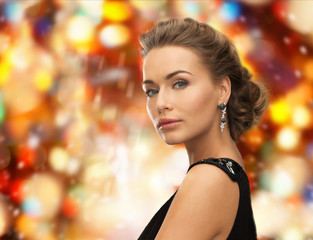 beautiful woman in evening dress wearing earrings