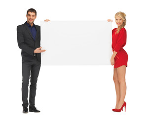 couple holding big blank white board