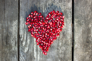 pomegranate macro seeds in heart shape