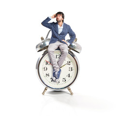 Man thinking and sitting on vintage clock