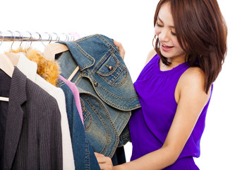 happy smiling asian woman choosing shopping clothes
