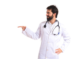 Doctor pointing to the lateral over white background