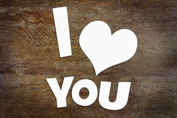 Text I Love You over wooden background