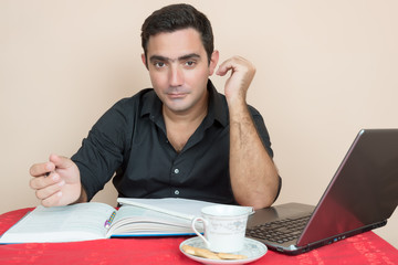 Hispanic man studying at home