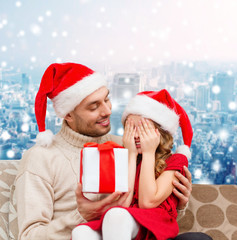 smiling daughter waiting for present from father