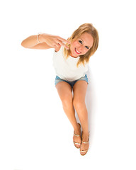 Woman doing victory gesture over white background