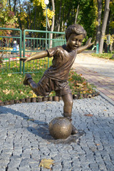Bronze sculpture of a boy