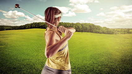 Woman golfing over beautiful landscape background.