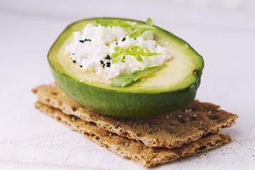 Sandwich of crispy bread wiht avocado