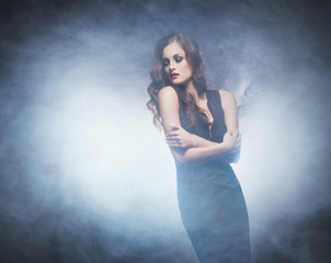 Young and emotional woman in fashion dress over glamour backgrou