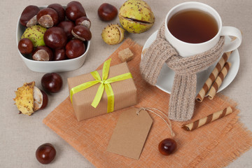 Gift Box With Blank Tag. Cup Of Hot Tea With Sweets. Chestnuts.