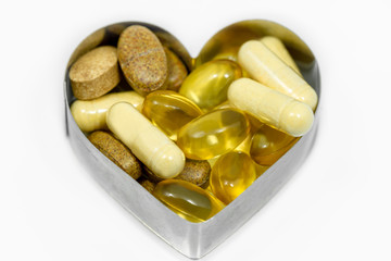 Multi Vitamin pills in heart isolated