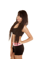 woman black and pink fitness side hand hip