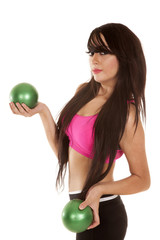 woman black and pink fitness green balls side