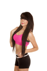 woman black and pink fitness stand side hand hip