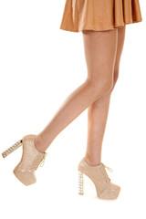 woman legs tan high heels walk side orange skirt