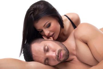 Brunette passionately biting ear of her lover