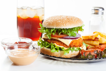 Chicken burger and glass of cola