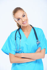 Smiling Medical Doctor on Light Blue Scrub Suit