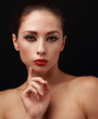Beautiful makeup woman with eyeliner on eyes and red lipstick