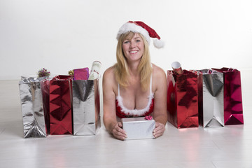 Party girl in a Santa hat with her presents