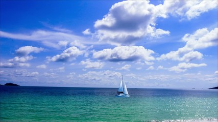 Timelapse Blue Sky and Cloudy over the ocean with sailing